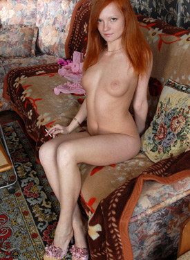 Redhead young smoking goddess wears pink string panties