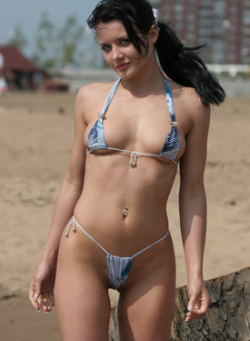 Exciting shy hottie in bikini on the beach