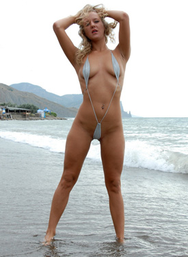 Exciting bikini girl with puffy nipples and the sea shore