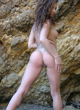 Puffy nipples brunette in pink bikini at the rocks