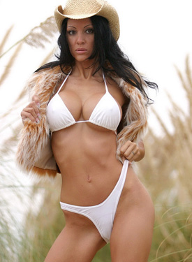 Latin busty brunette in white bikini outside