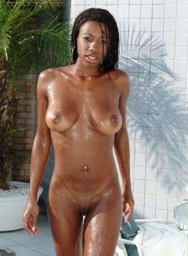 Wonderful sexy busty black girl with puffy nipples in orange bikini in the pool