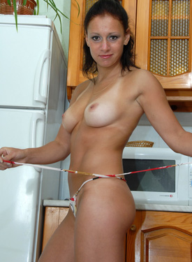 Puffy nipples chick in bikini in the kitchen