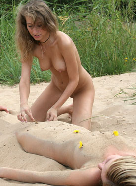 Puffy nipples three sexy chicks playing in the sand on the beach