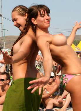 Candid topless girls dancing on the beach