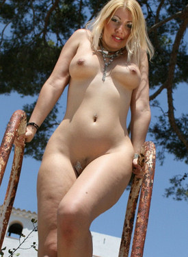 Blonde with big tits outside