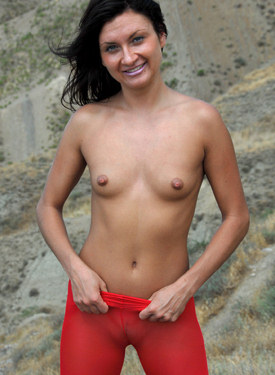 Puffy nipples babe appeared at the nature in red spandex with sexy erected nipples