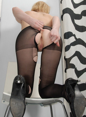 Playful blonde wears and rips sexy pantyhose