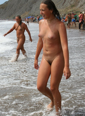 Hairy pussies naturist mother and daughter have fun on the beach and in the water