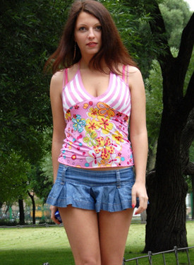 Seduced housewife appeared in the park wearing sexy jeans skirt and smoking