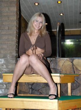 Blonde whore smoking in the sauna